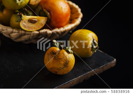 Sweet small persimmons 58838916