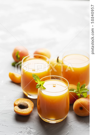Fresh apricot juice on the marble table 58840957