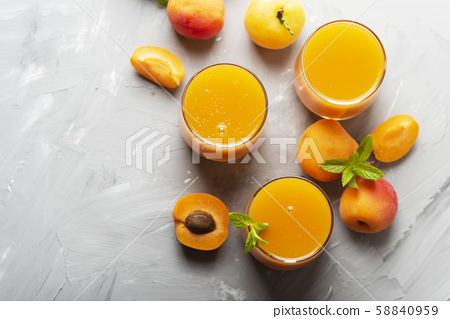 Fresh apricot juice on the marble table 58840959