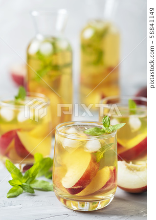 Summer cold tea with peaches and mint 58841149