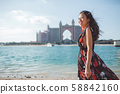 Dubai, United Arab Emirates. Pretty asian girl infront of Atlantis the Palm hotel from The Pointe 58842160