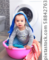 little boy at day of washing 58842763