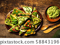 Avocado and vegetables sandwiches on a rustic 58843196
