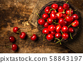 Colorful cherries on a wooden table 58843197
