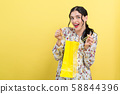 Woman with a shopping bag 58844396