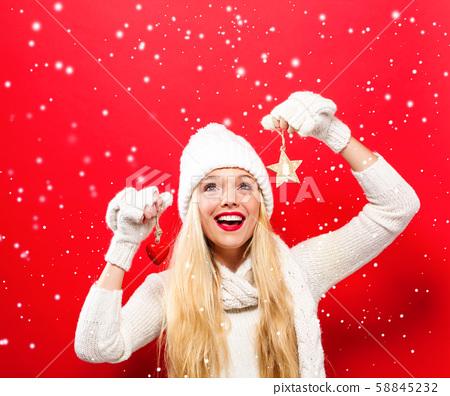 Woman holding Christmas ornament 58845232