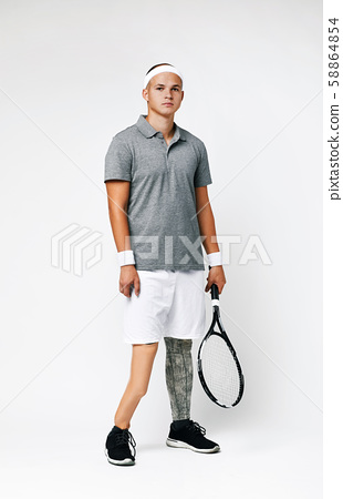 Paralympic sportsman with racket 58864854