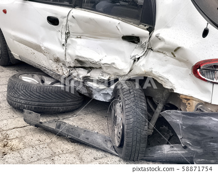 damaged automobile after collision in city 58871754