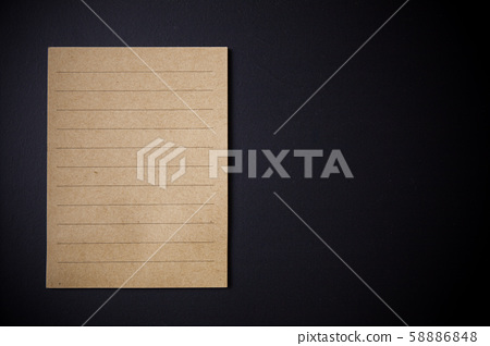 note paper on black background. 58886848