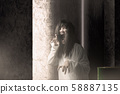 Scary ghost woman with blood and angry face 58887135