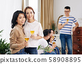 Party guests drinking beer from glasses 58908895