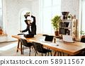Businessman having fun dancing break dance in the office at work 58911567