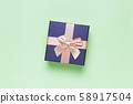 Gift Box On Green Paper Background 58917504