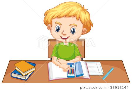 One happy boy doing homework on the desk 58918144