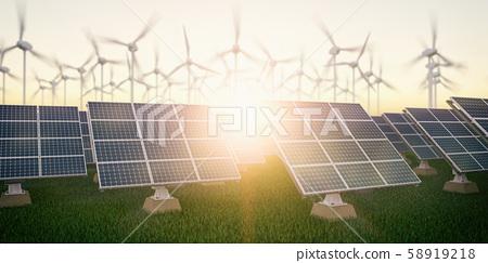 Solar panels with wind turbines on sunset summer 58919218