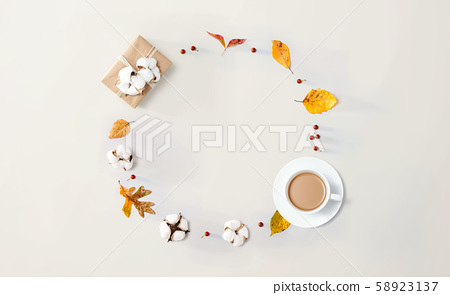 Autumn theme with a cup of coffee and a gift box 58923137