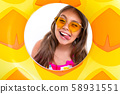 Happy girl with long crucified hair in sunglasses and swimsuit looks through inflatable circle hole 58931551