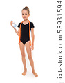 Picture of girl gymnast in black trico in full height with a jumping-rope around her neck and a 58931594