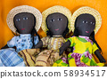 Row of rag dolls wearing traditional clothes, Madagascar 58934517
