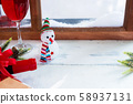 Snowman and Red wine for Christmas day 58937131