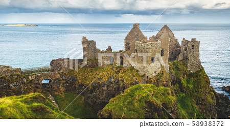 ruined ancient castle at seaside nothern ireland 58938372