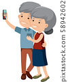 Elderly couple taking a photo together 58942602