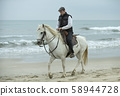 riding man and horse 58944728