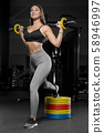 pretty caucasian fitness woman pumping up muscles 58946997