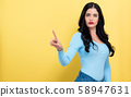 Young woman pointing at something 58947631