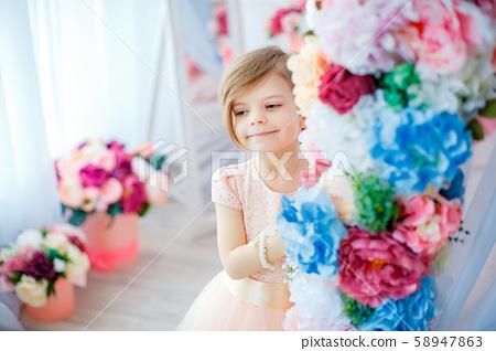 Smiling girl among flower 58947863