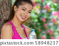 Chinese Asian Young Woman Girl Relaxing Drinking a Bottle of Water After Sport 58948237