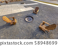 Chairs around a fire pit in Daybreak Utah park 58948699