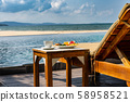 Summer vacation with coffee and tropical fruit at the beach 58958521