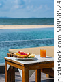 Vertical photo of breakfast with swimming pool background 58958524