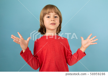 a teenage caucasian boy in a red jaket have irritate, picture isolated on blue background 58959286