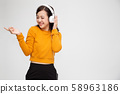 Beautiful young Asian woman with headphones 58963186
