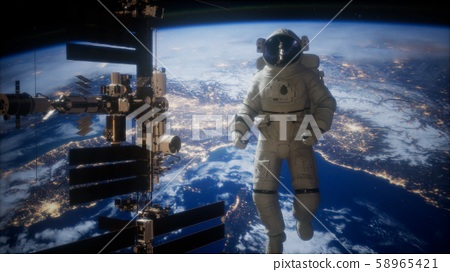 International Space Station and astronaut in outer 58965421