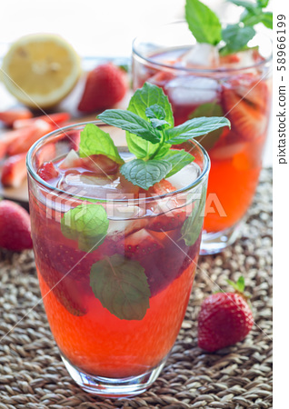 Glass of refreshing iced tea with strawberries 58966199