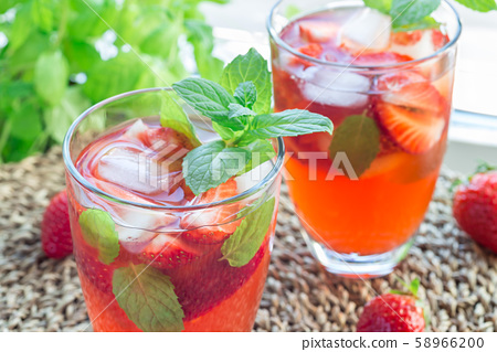 Glass of refreshing iced tea with strawberries 58966200