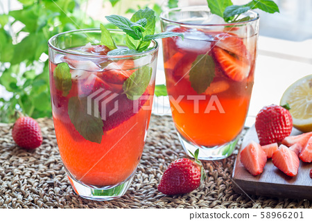 Glass of refreshing iced tea with strawberries 58966201