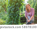 Smiling young woman is working by circular hand 58978100