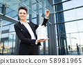 successful business womanposing on the background of urban modern office building 58981965