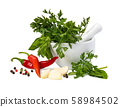 Fresh spices and herbs in mortar 58984502