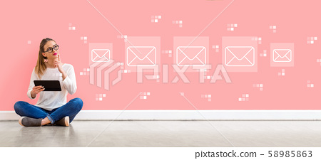 Emails with woman using a tablet 58985863