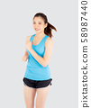 Beautiful young asian woman happy and smiling jogging isolated on white background 58987440