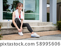 Asian girl tying shoe laces 58995606