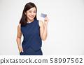 Young beautiful Asian woman smiling, showing, 58997562