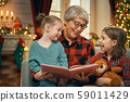 Grandmother reading  to granddaughters near 59011429