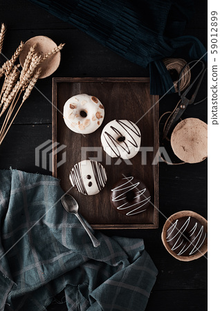 Different donuts on wooden table.. 59012899