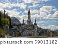 View of the cathedral in Lourdes, France 59013182
